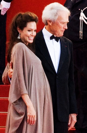 A pregnant Jolie with director Clint Eastwood at the Cannes premiere of Changeling in 2008