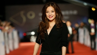 Chinese actress Vicki Zhao poses on the red carpet at the 50th Golden Horse Awards in Taipei, Taiwan, Saturday, Nov. 23, 2013. Zhao is a guest at this year's Golden Horse Awards, one of the Chinese-language film industry's biggest annual events. (AP Photo/Wally Santana)