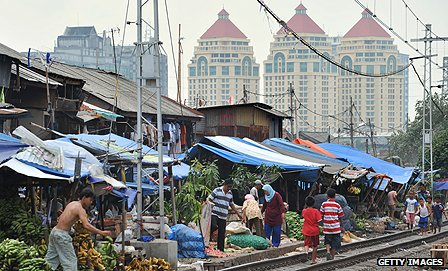 Traditional markets and modern high rises co-exist in the region's biggest economy