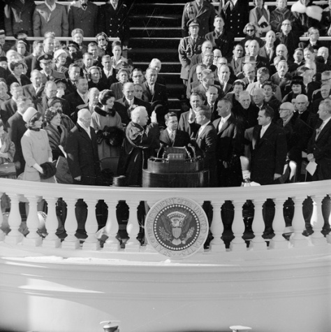 John F. Kennedy takes the oath of office administered by Chief Justice Earl Warren on January 20, 1961, at the Capitol