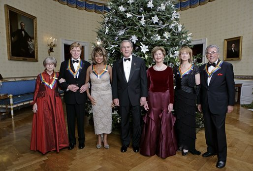 U.S. President George W. Bush and First Lady Laura Bush pose with the Kennedy Center honorees, from left to right, Julie Harris, actor Robert Redford, singer Tina Turner, ballet dancer Suzanne Farrell and singer Tony Bennett on December 4, 2005, during the reception in the Blue Room at the White House.