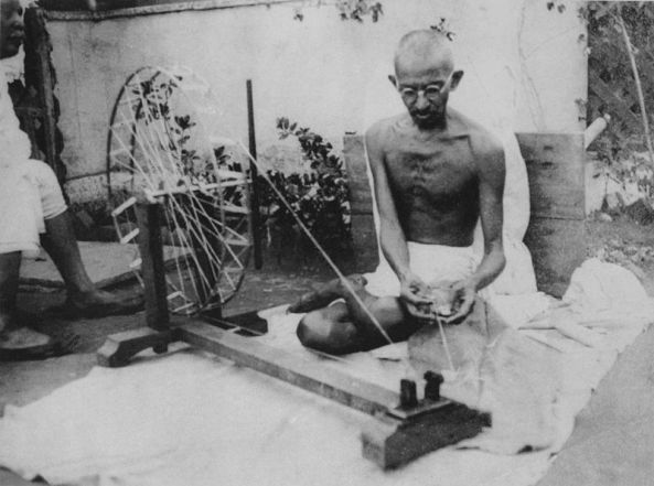 Mahatma Gandhi spinning yarn, in the late 1920s