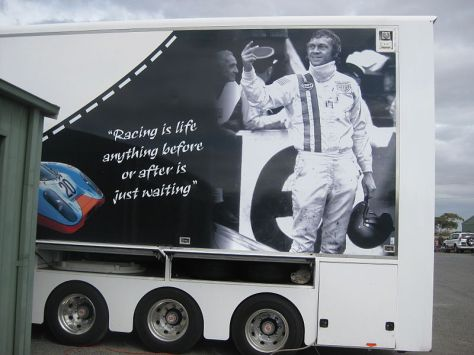 Modern advertisement with McQueen photo and quote.