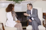 Houston met with President George H. W. Bush in the Oval Office in 1990, while in Washington, D.C., to participate in the Youth Leadership Forum
