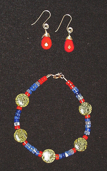 Necklace and earring set made from semiprecious stones. The spherical green beads are Russian serpentine. Also used are jasper (red) and fluorite (blue)