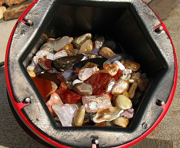 A 15 pound (6.8 kg) tumbler barrel full of glistening tumble-polished agate and jasper.