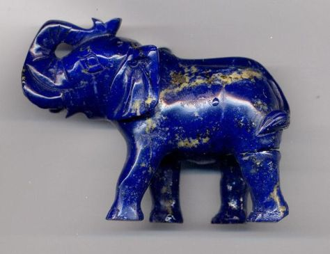 An elephant carving on high-quality lapis lazuli, that includes gold-colored pyrite, is a rare example of Mughal inspired art. (length: 8 cm (3.1 in))