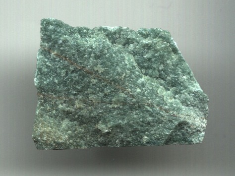 Aventurine is used for a number of applications, including landscape stone, building stone, aquaria, monuments, and jewelry. (Unknown scale)