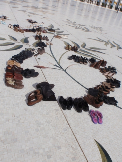 The Sheikh Zayed Grand Mosque. Shoes are left outside the mosque in the courtyard.