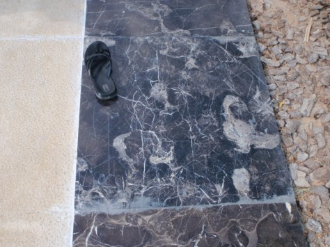 Sheikh Zayed Grand Mosque. More decorative stones (outside the main courtyard areas) with shoe for scale.