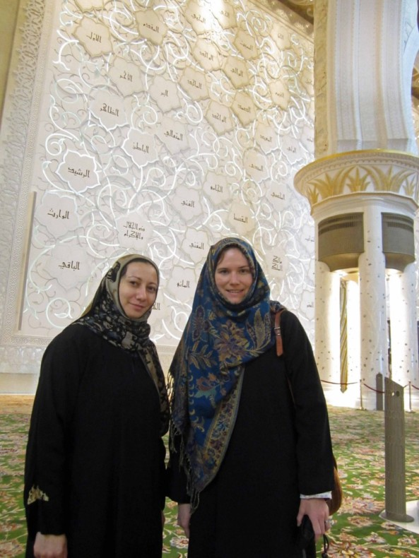 Sheikh Zayed Grand Mosque. Karima and I inside the mosque. The wall behind us features the 99 names of God in Islam.