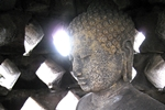 768px-buddha_in_the_stupa_borobudur-150x100