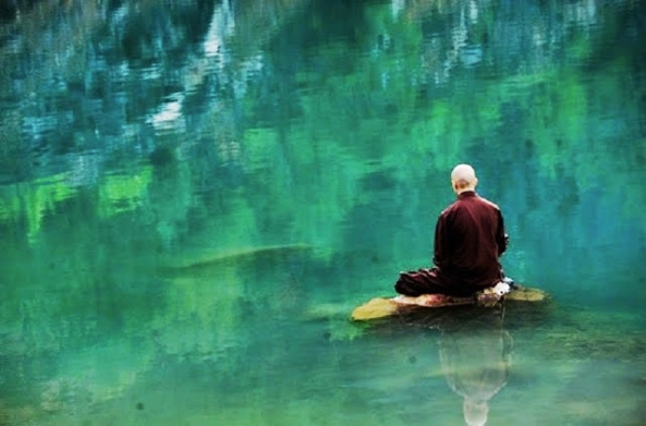 monk-meditating-on-rock-in-lake