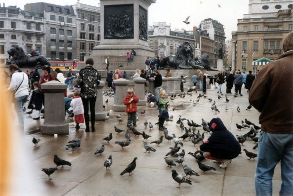 1280px-People_feeding_pigeons_in_Trafalgar_Square_c.1993