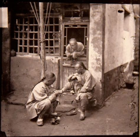 A_Pekingese_chiropodist._John_Thomson._China,1869._The_Wellcome_Collection,_London