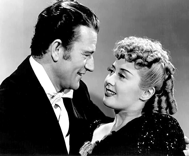 John_Wayne_-_Joan_Blondell_-_1942