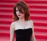 Russian Anna Chapman, who was deported from the U.S. in July 2010 on charges of espionage, poses on the red carpet at the opening ceremony of the 35th Moscow International Film Festival in Moscow, Russia, Thursday, June 20, 2013. (AP Photo/Alexander Zemlianichenko Jr)