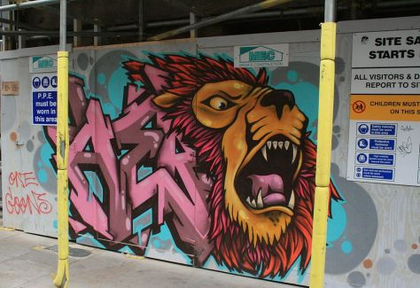 Graffiti_in_Shoreditch,_London_-_Lion_in_Brick_Lane_(13784222033)