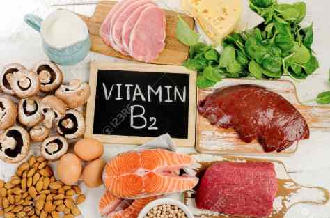 66526240-Foods-Highest-in-Vitamin-B2-Riboflavin-Healthy-eating-Flat-lay-Stock-Photo